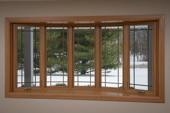 Bow window with prairie grids, vinyl windows, wood grain grids and golden oak interior in Franklin, WI