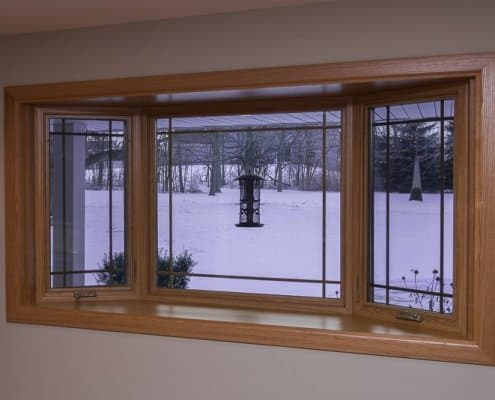 Bay window with prairie grids, golden oak interior stain and laminated seat in Franklin, WI
