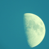 photo of phasing moon in waxing quarter